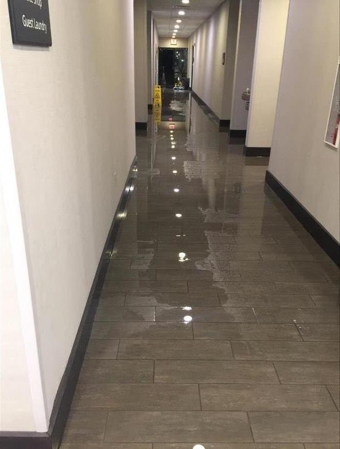 A hotel hallway after a broken pipe flooded the first floor